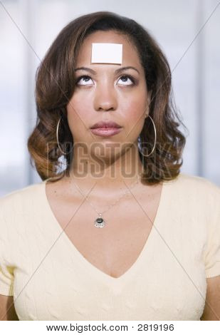 Businesswoman With A Blank Note On Her Forehead