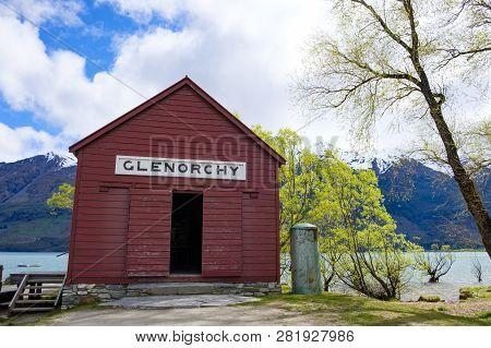 Distinctive Red Boathouse On The Shore Of Lake Wakatipu, Glenorchy, New Zealand