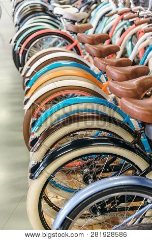 Rear Wheels Of Bicycles Standing In A Row, Selective Focus On First Wheel/ Painted Bike Mud Flaps/ B