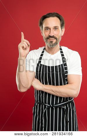 Man In Apron. Confident Mature Handsome Man In Apron Red Background. He Might Be Baker Gardener Chef