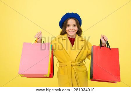 Mid Season Sale. Girl Cute Kid Hold Shopping Bags On Yellow Background. Shop With Discount Card. Get