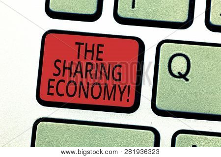 Handwriting Text Writing The Sharing Economy. Concept Meaning Systems Assets Or Services Shared Betw