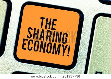 Conceptual Hand Writing Showing The Sharing Economy. Business Photo Showcasing Systems Assets Or Ser