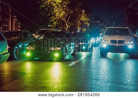 Night View Of The Cars. Road In The City At The Night With Yellow And Red Electrical Light For Cars