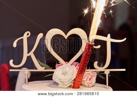 A Top O F Wedding Cake, Initials K & T And Flare