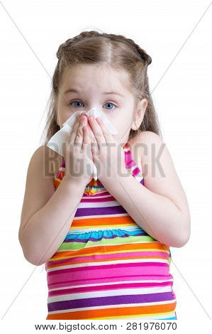 Child Girl Blowing Her Nose Into A Handkerchief Isolated On A White Background