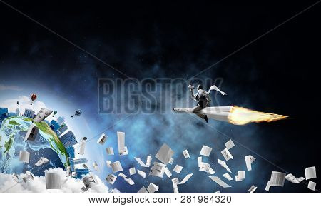 Conceptual Image Of Young Businessman In Suit Flying On Rocket Among Flying Papers With Planet Earth
