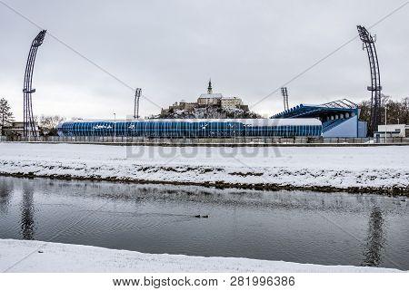 Castle, Football Stadium And River In Nitra, Slovak Republic. Winter Scene. Travel Destination.