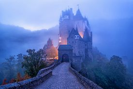 The Medieval Gothic Burg Eltz Castle In The Morning Mist, Germany. Eltz Castle Is One Of The Most Im