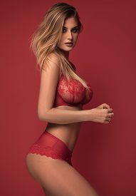 Sensual Woman In Red Lingerie.