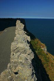 Narrow Road Atop The Cliffs Overlooking The Irish Sea At Llandudno (wales, Uk) With Shadow From An O