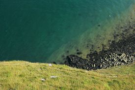 View Looking Downwards From The Cliffs Overlooking The Irish Sea At Llandudno (wales, Uk). Green Hil