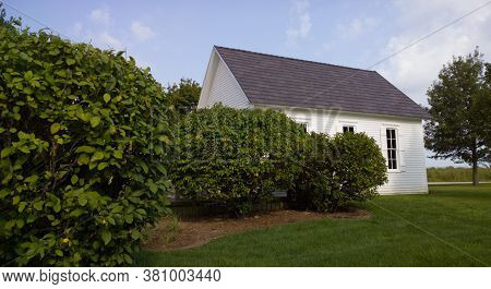 White One Room School House Among The Fields In Rural Midwest In Summer