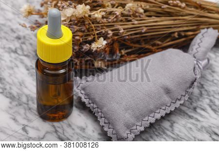 Essential Oil And Lavender Flowers. Selection Of Essential Oil On Marble Tabel With Various Organic