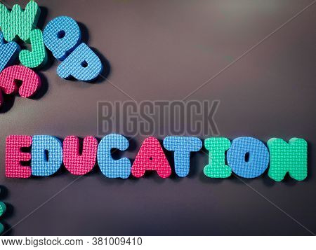Education Alphabet In Vintage Background. Stock Photo.