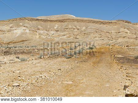 Rocky Hills Of The Negev Desert In Israel. Breathtaking Landscape Of The Desert Rock Formations In T