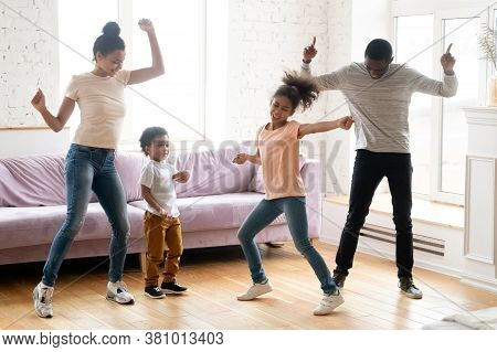 Active Black Family With Children Dancing At Home