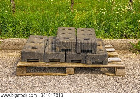Weighted Concrete Temporary Fence Post Bases For Interlocking Fence Panels On Wooden Pallets At The