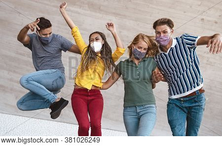 Young Friends Dancing Together While Wearing Face Mask Outdoor - Happy People Having Fun In City Aft