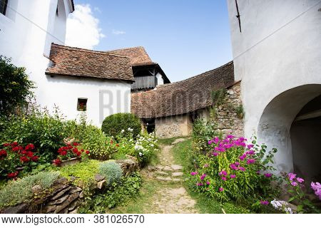 Viscri, Romania - August 5, 2020: Viscri fortified church in the Transylvania region of Romania is in UNESCO World Heritage Site.