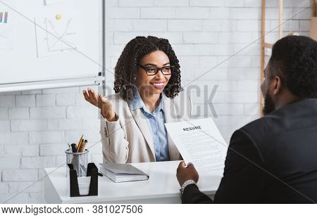 Friendly Personnel Manager Interviewing Black Candidate During Job Interview At Modern Office, Panor