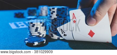 Man Plays Poker In The Casino. Holding Cards In Hand, Gambling Concept. Wide Image Background With C