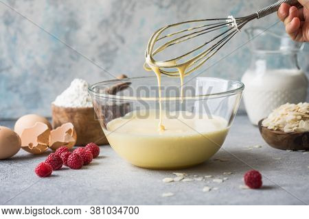 Dough For Making Pancakes Or Sponge Cake In A Bowl With A Whisk In The Kitchen. Dough For Making Pan