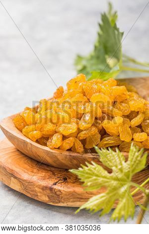 Golden Raisins. Golden Raisins Or Sultana In Bowl On Stone Background. Dried Fruit, Healthy Snack Fo