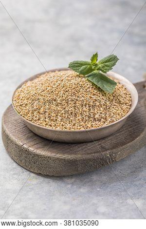 Raw White Quinoa Seeds (lat. Chenopodium Quinoa) On Plate. Raw Quinoa Seeds