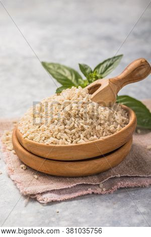 Unpolished Brown Rice  In Bowl. Unpolished Brown Rice And White Polished Rice In Wooden Spoon. Long
