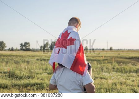 Canada Flag. Canadian National Holiday. 1 July. Happy Canada Day. Attractive Old Senior  Man And Gra