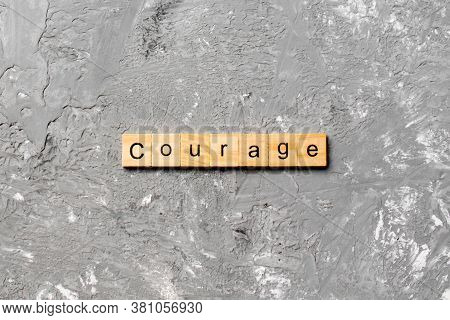 Courage Word Written On Wood Block. Courage Text On Cement Table For Your Desing, Concept