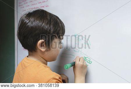 Portrait School Kid Drawing Cartoon Tank On White Board, Child Boy Holding Colour Pen Write On Board