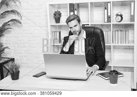 Surfing For Business Information. Businessman Do Business Online. Handsome Man Work On Computer In O