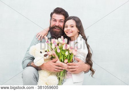 Best Day Ever. Happy Family Celebrate Holiday. Little Child And Father Hold Flowers And Toy. Holiday