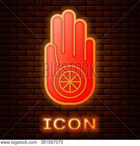 Glowing Neon Symbol Of Jainism Or Jain Dharma Icon Isolated On Brick Wall Background. Religious Sign