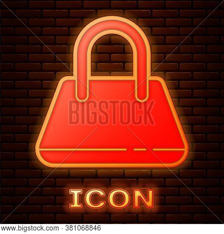 Glowing Neon Handbag Icon Isolated On Brick Wall Background. Female Handbag Sign. Glamour Casual Bag