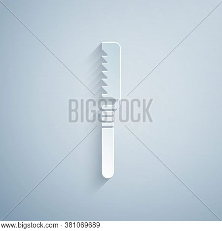 Paper Cut Medical Saw Icon Isolated On Grey Background. Surgical Saw Designed For Bone Cutting Limb