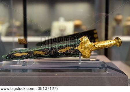 Athens - May 7, 2018: Bronze Sword With Gold Hilt Revetment From Greek Mycenae (mykines) In National