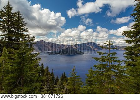 Crater Lake In National Park, Blue Water In A Forest Lake With Pine Trees, View Of A Beautiful Lake