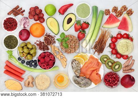 Immune  boosting healthy super food collection for fitness with health foods high in antioxidants, anthocyanins, vitamins, minerals, protein, omega 3 and fibre. Flat lay.