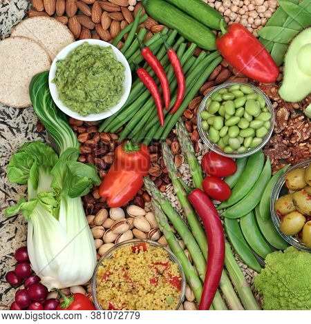 Vegan health food diet with foods high in omega 3, protein, vitamins, minerals, anthocyanins, antioxidants, smart carbs and dietary fibre. Healthy ethical eating concept. Flat lay.