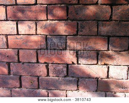Dappled Sunshine On Old Brick Wall
