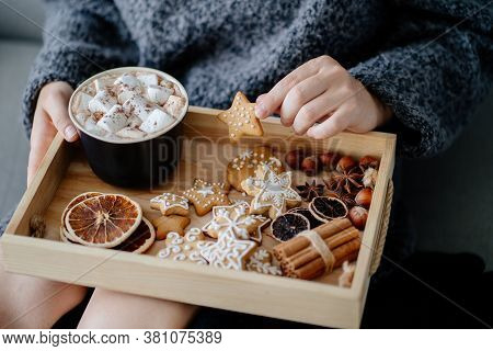 Hygge, Christmas Holidays. Cozy Home Concept. Woman Eating Festive Sweets With Hot Chocolate. Winter