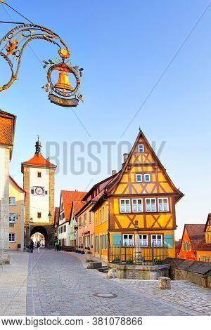 Old street in Rothenburg ob der Tauber in Bavaria, Germany. Sign: Gasthof (ger.) - Guesthouse