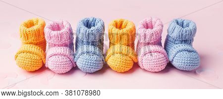 Pregnancy Motherhood Perenthood Concept, Three Pairs Of Baby Booties On Pink Background, Baby Shower