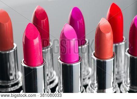 Lipstick. Fashion Colorful Lipsticks over black background. Lipstick tints palette, Professional Makeup and Beauty. Beautiful Make-up concept. Lipgloss.