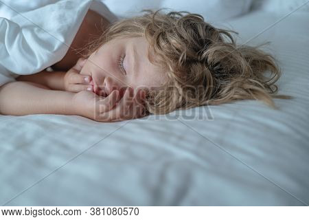 Kids On Sleeping Bed, Happy Bedtime In White Bedroom. Kid Sleep In Bed
