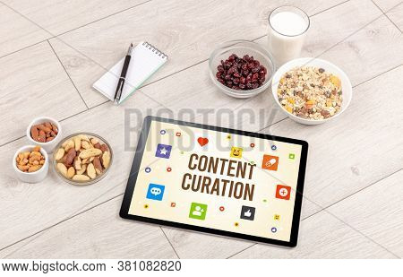 Healthy Tablet Pc compostion with CONTENT CURATION inscription, Social networking concept