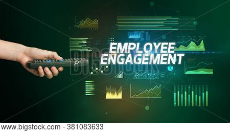 hand holding wireless peripheral with EMPLOYEE ENGAGEMENT inscription, cyber business concept